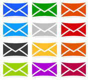 Envelope symbols in 12 colors as contact, support, email icons, Stock Images