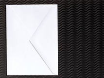 Envelope on textured background Royalty Free Stock Photos