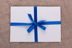 The envelope tied with a blue ribbon on sacking Stock Images