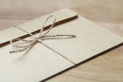 Envelope tied with string. Close-up of envelope tied with string Royalty Free Stock Photography