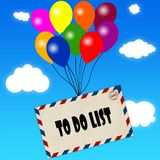 Envelope with TO DO LIST message attached to multicoloured balloons on blue sky and clouds background. Stock Image
