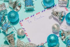 Letter to santa claus a letter of wish list on a blue background. Envelope to Santa claus on a blue background. Lay flat Stock Photo