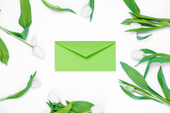 Envelope and tulips Stock Photography