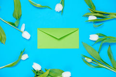 Envelope and tulips Royalty Free Stock Image