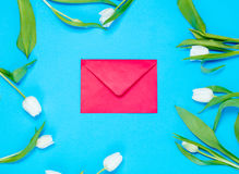 Envelope and tulips Stock Image
