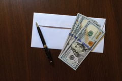 Envelope and 100 US dollar banknotes Stock Photography