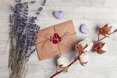 Envelope with wax seal and lavender on wooden background. Stock Photo