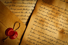 Envelope with wax seal and old letters Royalty Free Stock Image
