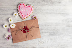 Envelope with wax seal and tulips on wooden background. Stock Image