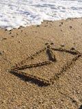 Envelope on wet sea sand Royalty Free Stock Photos