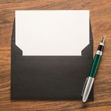 Envelope with white paper and pen Stock Photo