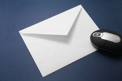 Envelope and wireless mouse Stock Photography