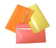 Envelopes. Pink, orange, yellow envelopes on white Royalty Free Stock Photo