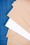 Envelopes. Isolated on the blue background Stock Photos