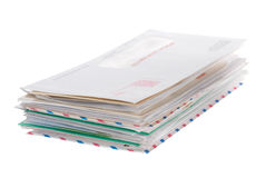 Envelopes. A stack of snail mail envelopes isolated on white Stock Images