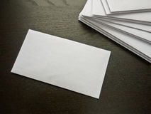 Envelopes. A stack of envelopes on a desk waiting to be addressed and stamped with one envelope perfect for adding copy Royalty Free Stock Photo