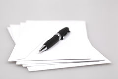 Envelopes and ball pen Stock Photography