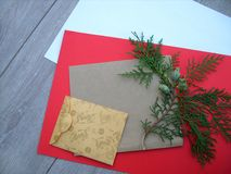 Envelopes and branches of thuja tree royalty free stock photography