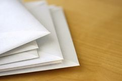 Envelopes on desk II Stock Photo