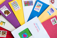 Envelopes of different colors with Love Stamps. Pile of envelopes of different colors with Love Stamps Stock Photos