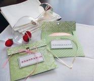 Envelopes for disks. white napkins and wine glasses Stock Photos