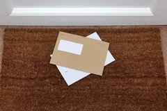 Envelopes on the doormat Royalty Free Stock Image