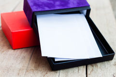 Envelopes in open gift box Stock Images