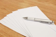 Envelopes with a pen on a table Stock Photography
