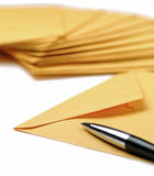 Envelopes and pen on white background Stock Photography