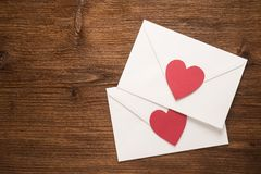 Envelopes with red hearts Stock Images