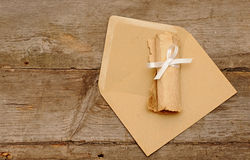 Envelopes with roll old paper Royalty Free Stock Photo