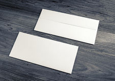 Envelopes on wood background. Two blank envelopes on wood background. Front and back side stock photo