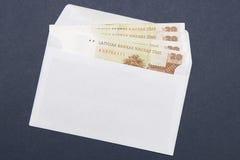Enveloppe avec l'argent Image stock