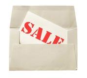 Enveloppe avec la note de vente photographie stock