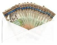 Enveloppe avec le Canadien cents billets d'un dollar Photos stock