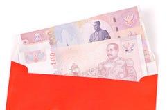 Enveloppe de type chinois avec de l'argent Photographie stock libre de droits