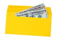 Enveloppe jaune avec de l'argent Photographie stock