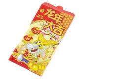 Enveloppe rouge chinoise de dragon Photographie stock