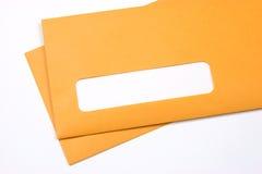 Enveloppes de Manille au-dessus de blanc Photos stock