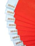 Enveloppes rouges chinoises d'an neuf avec la devise taiwanaise Photographie stock libre de droits