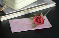Envenlope letter with rose. Royalty Free Stock Photography