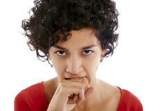 Envious hispanic woman biting finger Royalty Free Stock Image