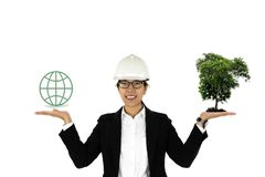Enviroment concept woman construction hand holding tree and globe icon isolated. Enviroment concept woman construction hand holding tree and globe icon isolated stock photography