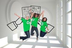 Enviromental activists jumping and smiling Royalty Free Stock Photos