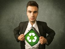 Enviromentalist business man tearing off shirt with recycle sign Stock Images