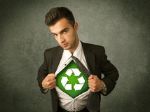 Enviromentalist business man tearing off shirt with recycle sign Royalty Free Stock Photos
