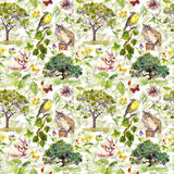 Environment: bird, rabbit, tree, leaves, flowers and grass. Repeating pattern. Watercolor. Environment - bird, rabbit, green tree, leaves, flowers and grass royalty free stock photography
