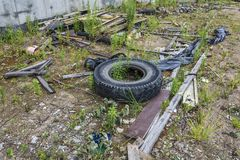 Environment. Car tires and construction debris dumped on the gro royalty free stock photo