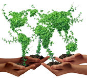 Environment Community. And business development concept as a group of global ethnic people hands holding green plants with leaves shaped as the world as a Royalty Free Stock Images
