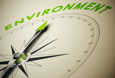 Environment. Compass with needle pointing the word environment, green and beige tones. Background image for illustration of environmental concept Royalty Free Stock Images